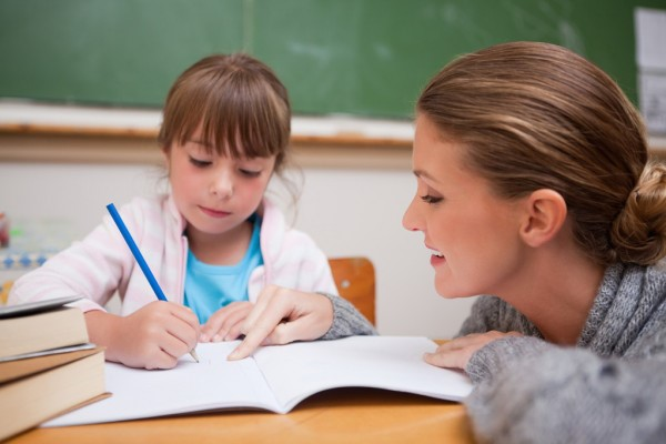 Image of a mother helping her daughter in studies